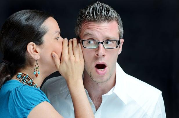 Woman whispering into mans ear.jpeg