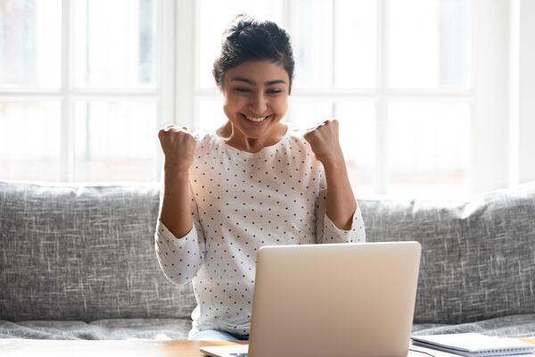 woman excited about receiving online payments